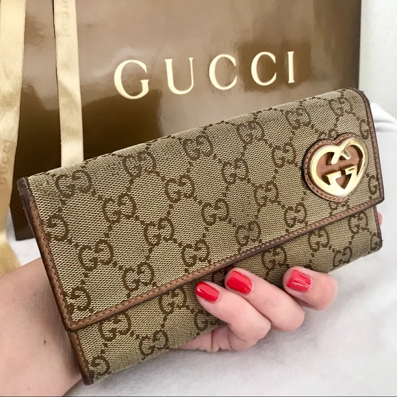 93f10a018de4 Gucci Handbags - GUCCI Lovely Heart GG Canvas &Leather Long Wallet